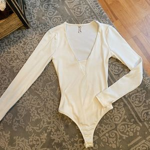 Free people white body suit.